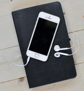 iPhone-on-Book-With-Earbuds