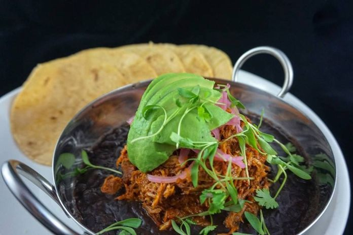 La Mulita tortillas with black beans, pulled meat, and avocado
