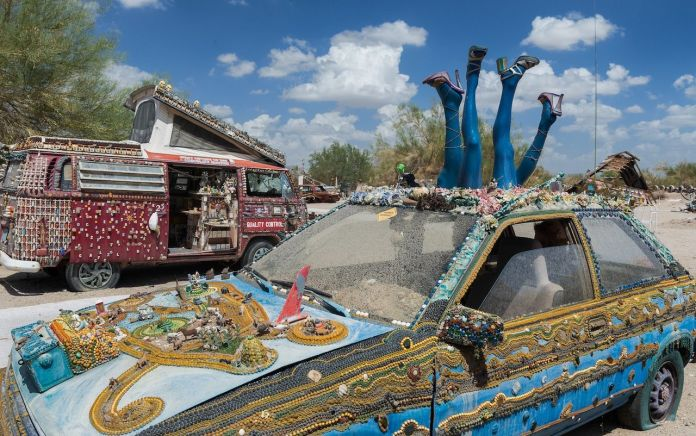 Decorated car and van in the desert in Slab City
