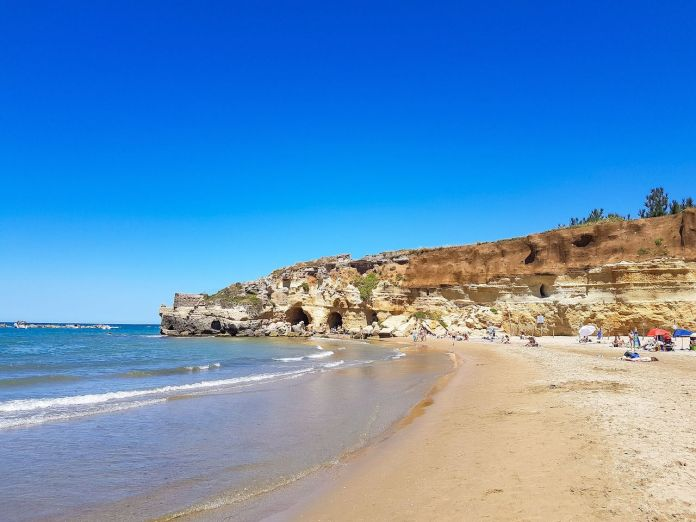 The beach at Grotte di Nerone with people and sea