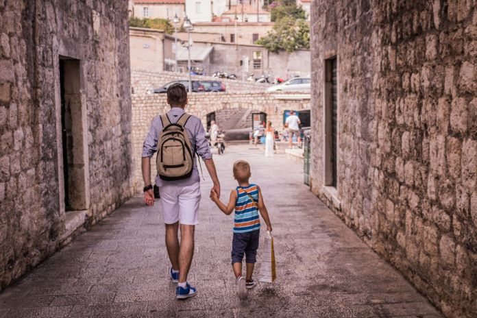 Parent and child walking through old town