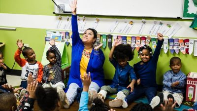 Woman leading preschoolers in movement