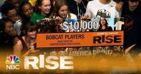 Bobcat Players kids holding an $10,000 Dare to Dream Rise oversized check