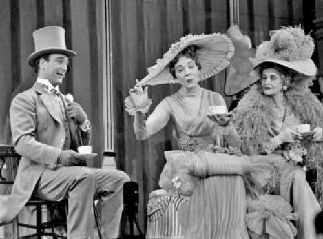 Julie Andrews and other cast members during a scene from the play 'My Fair Lady.'