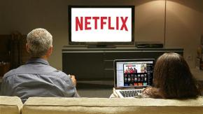 Couple watching Netflix on their couch.