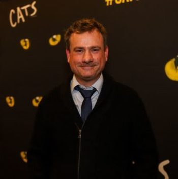 Man in front of CATS signage
