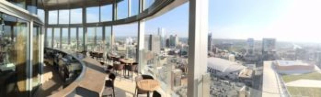bar and tables overlooking Nashville skyline