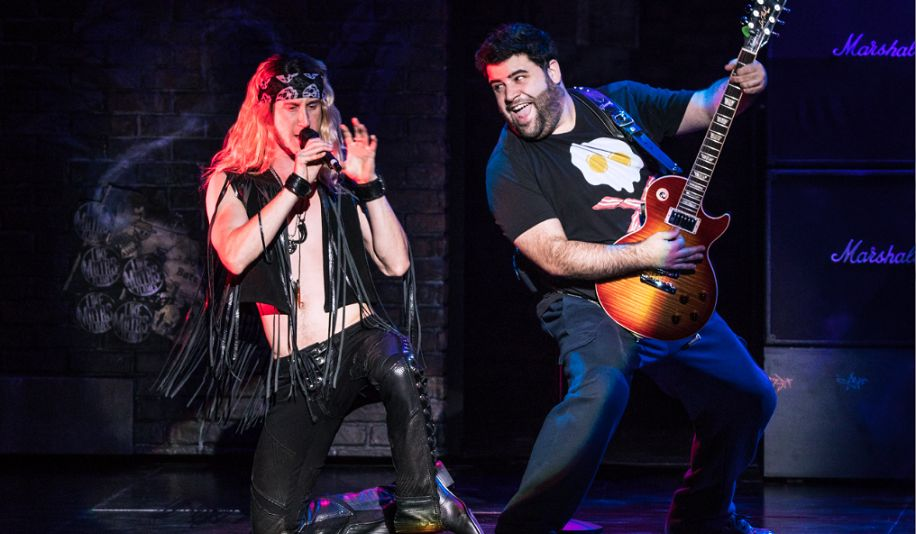 two actors on stage in School of Rock the Musical