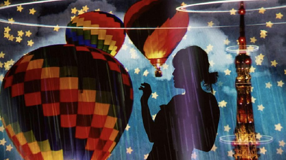 silhouette of woman in front of hot air balloons and stars
