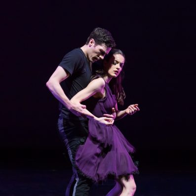 woman and man dancing alone onstage