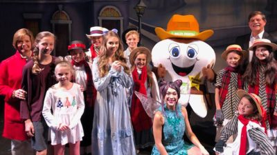 Delta Dental representatives and Peter Pan cast on stage