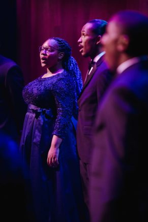 three performers from Fisk Jubilee Singers onstage at TPAC