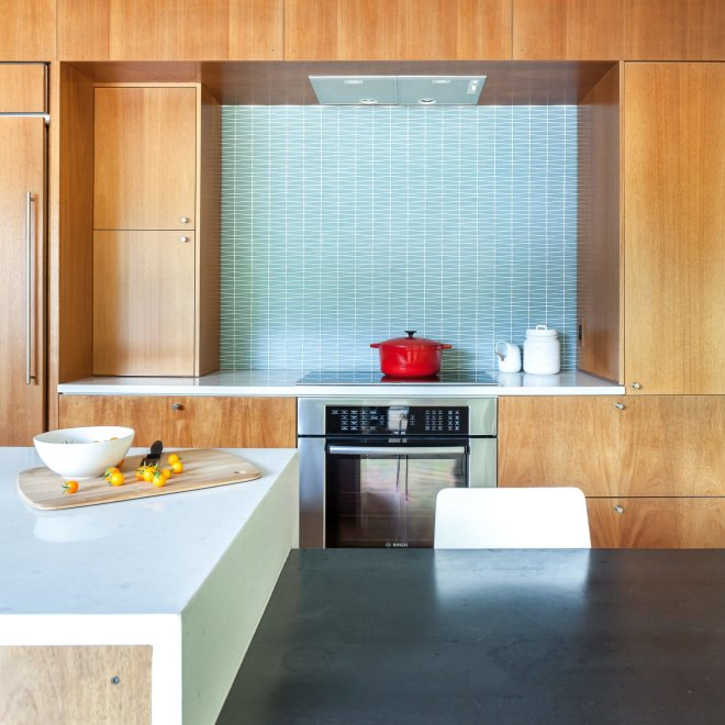 25 Backsplash Ideas For Your Kitchen Renovation - Photo 2 of 25 - The stools are from Crate & Barrel. The Hobsons chose a geometric-patterned glass tile backsplash by Island Stone. Induction cooktop and oven are by Bosch.