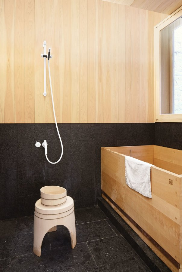 Secrets You Need to Know When Using Wood in Wet Spaces - Photo 10 of 11 - A Japanese hinoki bowl and stool from Mjölk sit next to a custom hinoki bathtub by Bartok Design in the tub room.