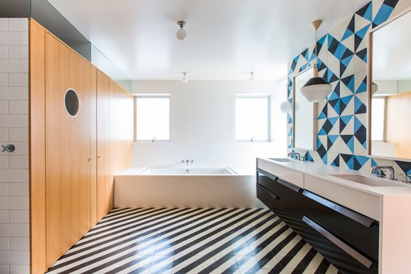 Architect Barbara Bestor added a striped floor of Santander Granada Tile, Douglas Fir cladding, and Granada Serengeti tile flipped to create a one-of-a-kind pattern on the wall.