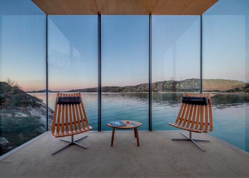 10 Gravity-Defying Cantilevered Homes - Photo 13 of 23 - The large expanses of glass frame views that were perfectly planned. The seating areas are furnished with Scandia lounge chairs that were designed by Hans Brattrud in the 1950s and are now being produced by Fjordfiesta.