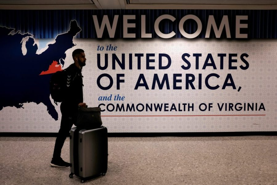 Iranian Americans in limbo after Trump s new travel rules   PBS NewsHour An international passenger arrives at Washington Dulles International  Airport in Virginia after the Supreme Court granted