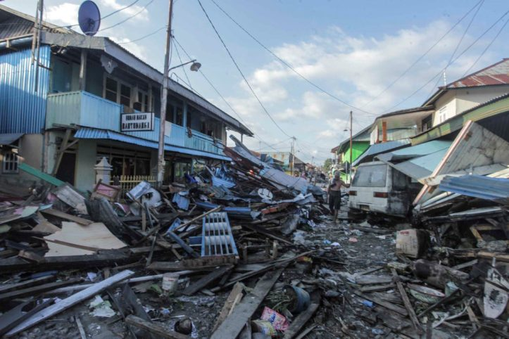 A man walks on a street after an earthquake and tsunami hit the area in Wani, Donggala, Central Sulawesi, Indonesia October 1, 2018 in this photo taken by Antara Foto. Antara Foto/Muhammad Adimaja/ via REUTERS