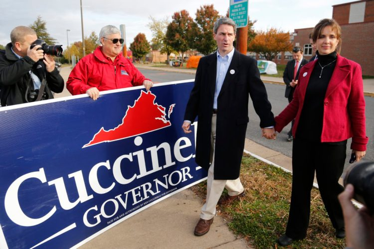 Ken Cuccinelli and his wife Teiro Cuccinelli depart after casting their ballots during Virginia's gubernatorial race in 2013. During his unsuccessful bid for governor, Cuccinelli said he supported immigration reform, although he advocated strict immigration policies during his time in public office. Photo by Jonathan Ernst/Reuters
