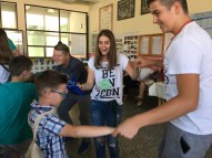 Adna and Faris dance with the campers