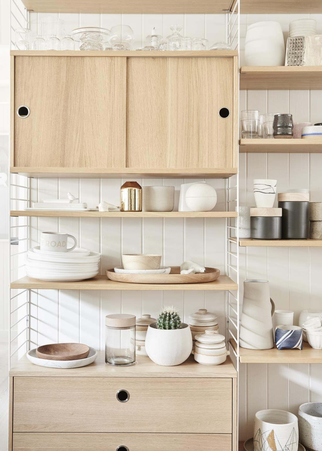 If you want to opt for sliding cabinet doors in your kitchen, make sure they work well with your existing decor.