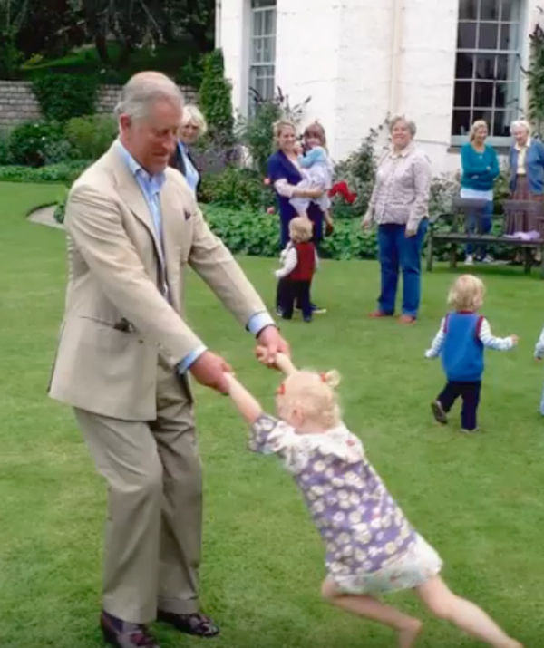 The Prince playing with little Lola Parker Bowles, granddaughter of Camilla, Duchess of Cornwall. (Image: BBC/Clarence House)