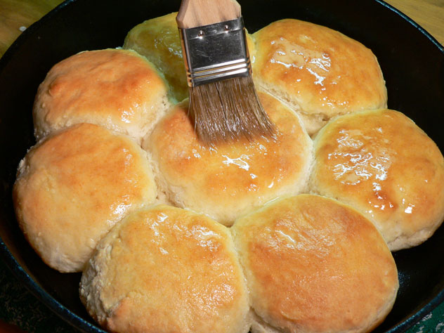 Right after you take them out of the oven, brush the tops with some melted Butter. Let it run down around the edges and in between the biscuits.