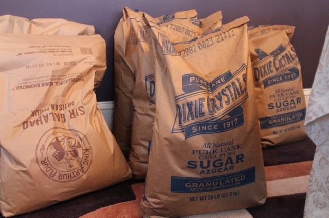 Commercial-size bags of King Arthur flour and Dixie Crystals sugar rest in Claire Putterman's dining room in Charlotte for use in her muffins.