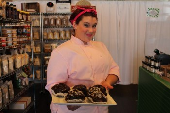 Emily Divers of See Jane Bake shows off a tray of her éclairs at the Provisions by Sandy Creek store in Waxhaw.