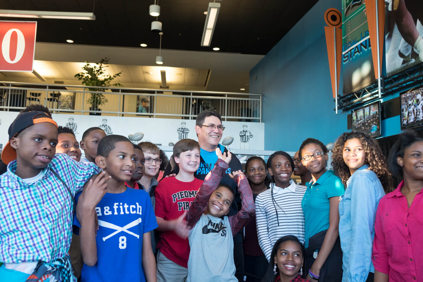 Panthers coach Ron Rivera poses for a quick picture with academy students before a live broadcast of Panther Talk.