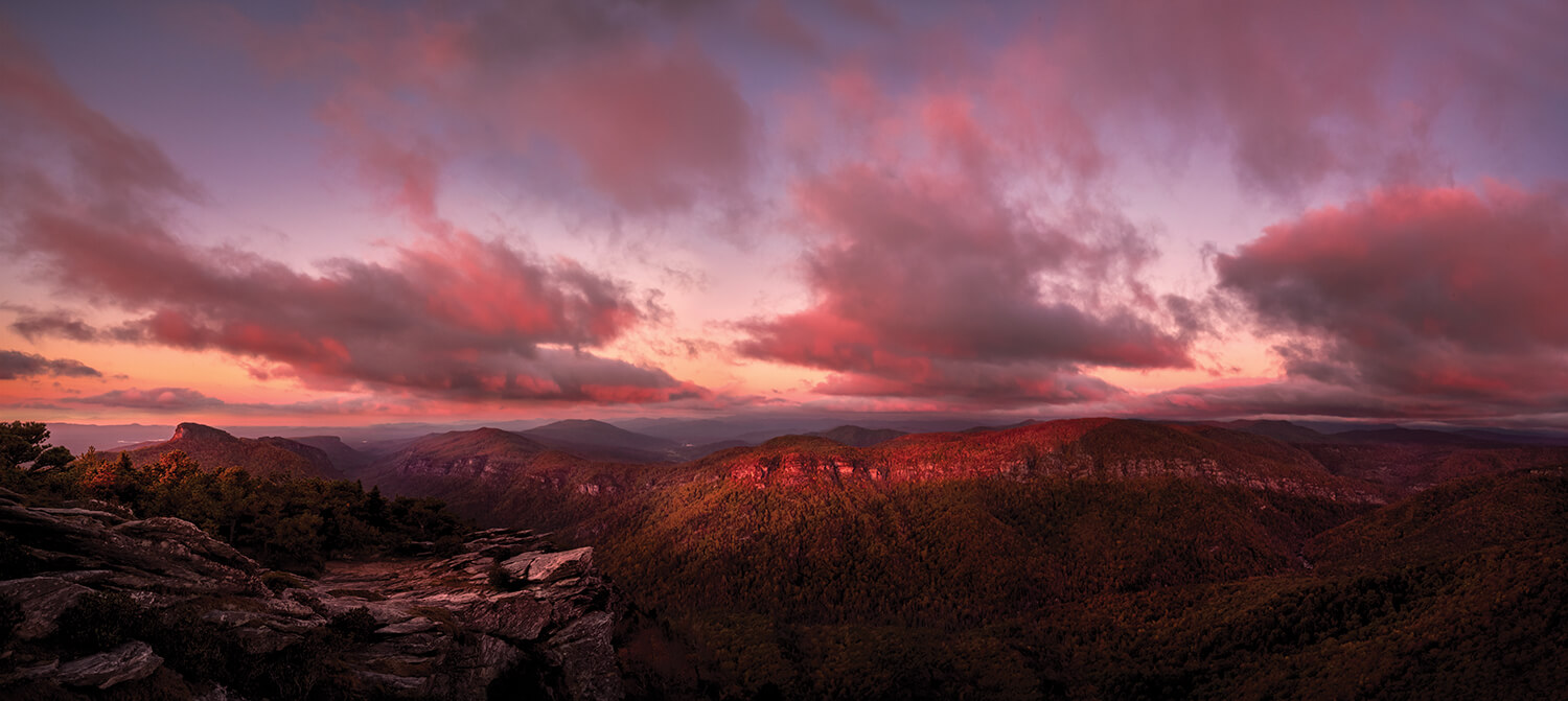 """Sometimes called """"the Grand Canyon of North Carolina,"""" Linville Gorge — here, with Hawksbill Mountain — spans more than 10,000 acres of virgin forests; no industrial logging ever took place here. Of the four major gorges in the state, Linville Gorge is the only one without a road in the bottom. Photograph by Tommy White."""