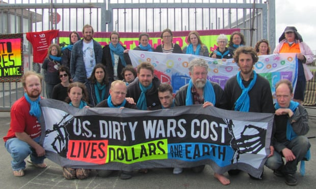swan island activists at gates with banners guardian photo