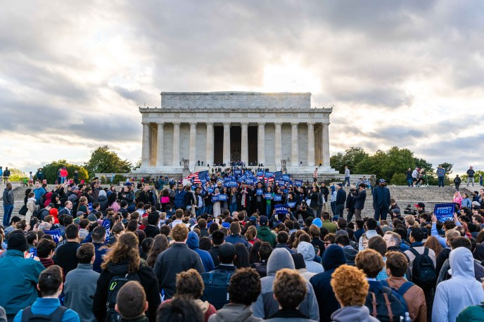 Andrew Yang, Lincoln Memorial in the background, addresses the large crowd assembled to hear him talk about the future of the country