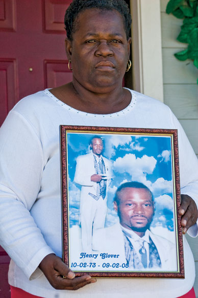 Edna Glover holds a portrait of her son, whose remains were found behind a police station. CHANDRA MCCORMICK AND KEITH CALHOUN