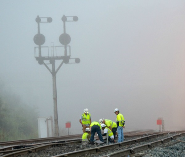 Signal work on a switch at dawn