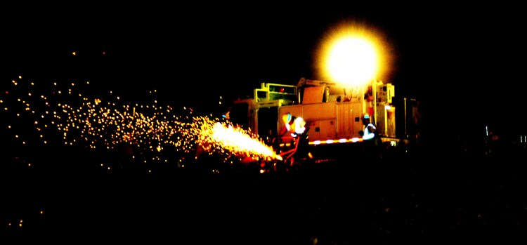 Railroad Track Workers Grinding Rail at Night
