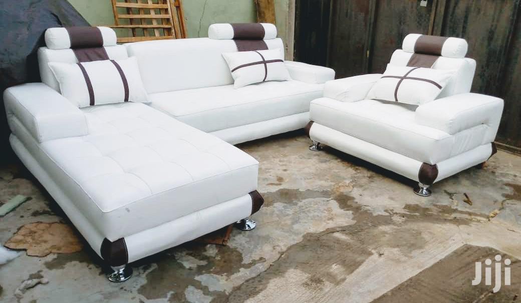 l shaped sofas and single seater chair white leather couches