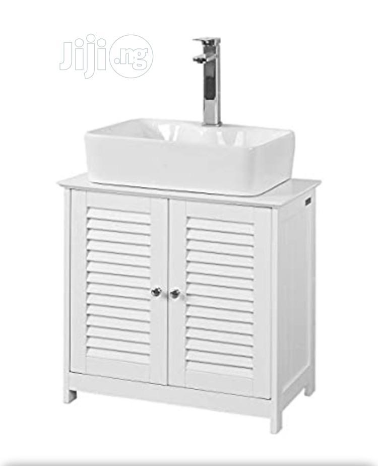white under sink bathroom storage cabinet with double doors