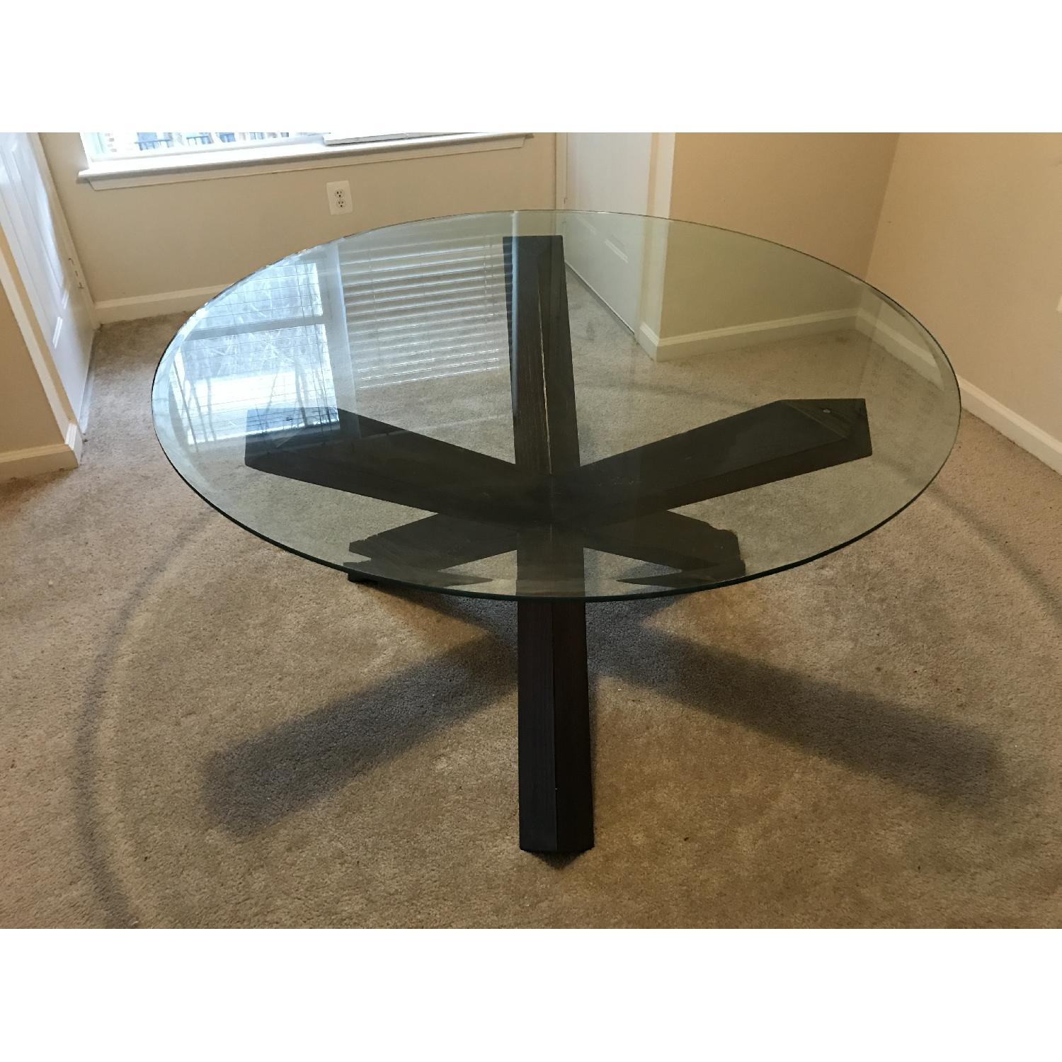 rooms to go contemporary cross legged dark espresso brown wood round glass dining table