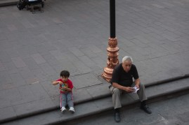 A child enjoying an evening out with grandpa
