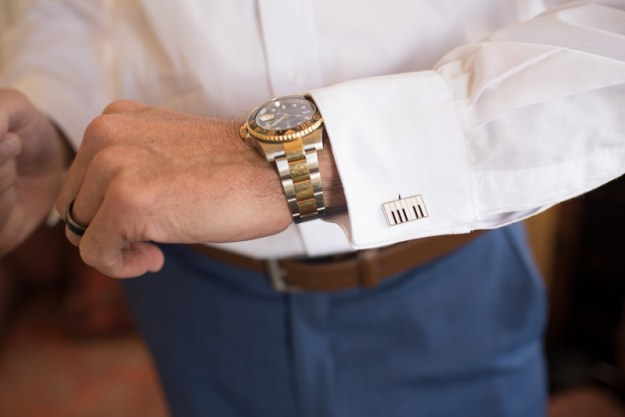 Male arm with wrist watch and piano key cufflinks