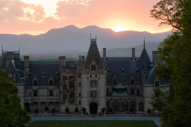 Biltmore Estate with mountains and sunset in background