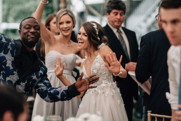 Bride and friends dancing during wedding reception