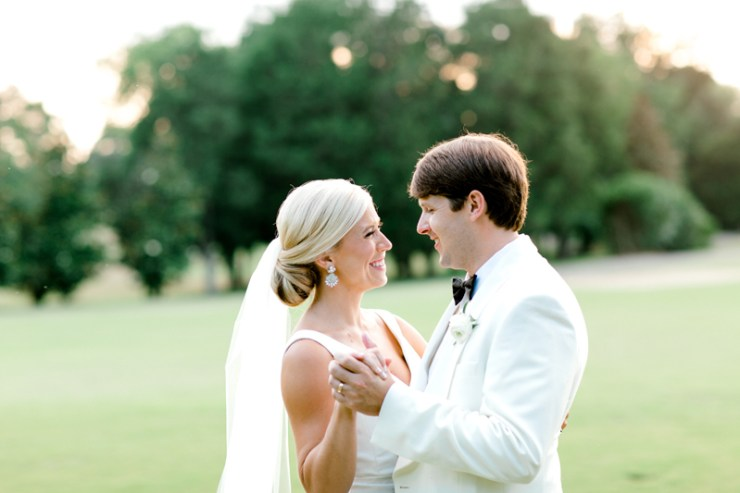 Bride and groom's first look on golf course
