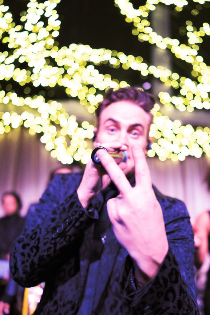 Vocalist for wedding band, Powerhouse, performing at a tented wedding reception in New Orleans.