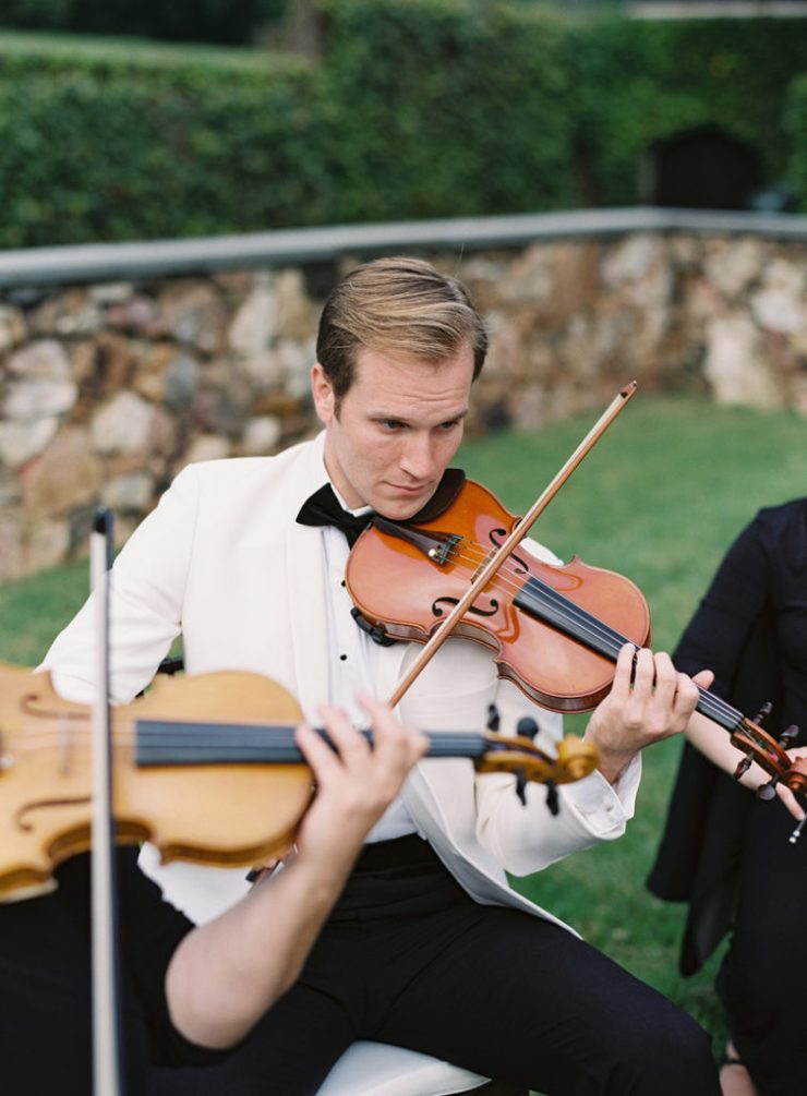 Violinist at outdoor garden wedding