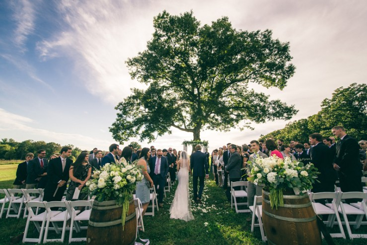 Bride and groom during wedding ceremony a Summerfield Farms