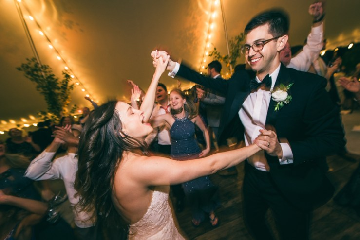 Couple happily dancing to Right to Party band during Greensboro, NC wedding reception.