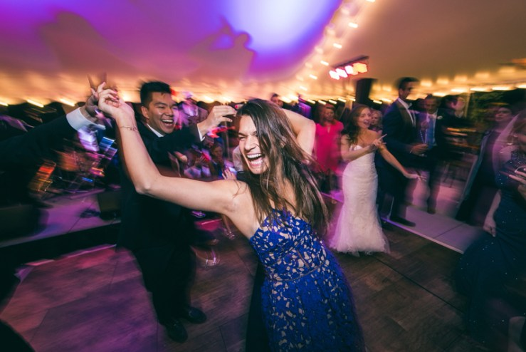 Couple laughing and dancing during wedding reception at Summerfield Farms.