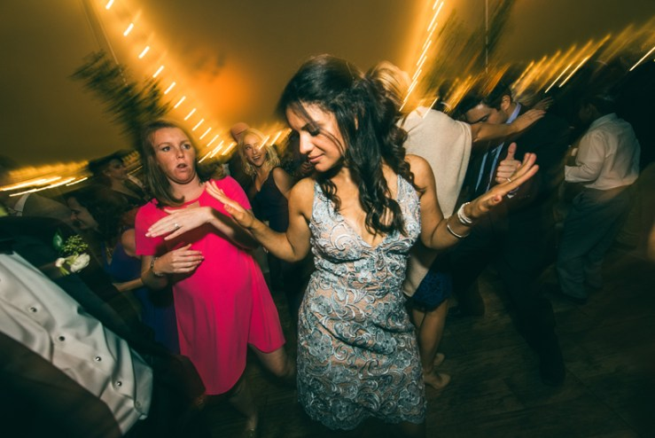 Crowded dance floor during wedding reception at Summerfield Farms.